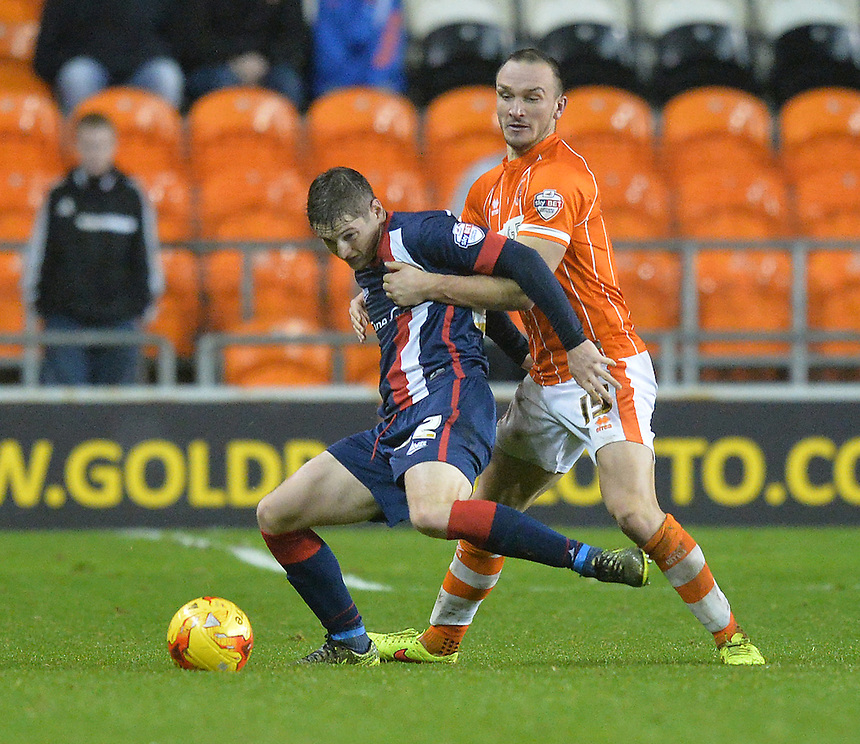 Blackpool's Tom Aldred battles with Doncaster Rovers' Conor Grant<br /> <br /> Photographer Dave Howarth/CameraSport<br /> <br /> Football - The Football League Sky Bet League One - Blackpool v Doncaster Rovers - Saturday 14th November 2015 -   Bloomfield Road - Blackpool<br /> <br /> &copy; CameraSport - 43 Linden Ave. Countesthorpe. Leicester. England. LE8 5PG - Tel: +44 (0) 116 277 4147 - admin@camerasport.com - www.camerasport.com