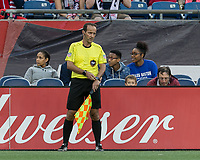 Foxborough, Massachusetts - October 15, 2017: In a Major League Soccer (MLS) match, New England Revolution (blue/white) defeated New York City FC (light blue/blue), 2-1, at Gillette Stadium.<br /> Assistant referee Claudiu Badea synchronize watches.