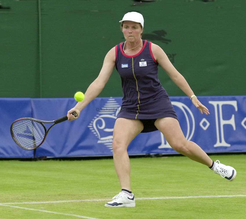 Photo. Richard Lane. .DFS Classic, Edgbaston, Birmingham. 15/6/2000.Nathalie Tauziat returns during the first set of the third round.