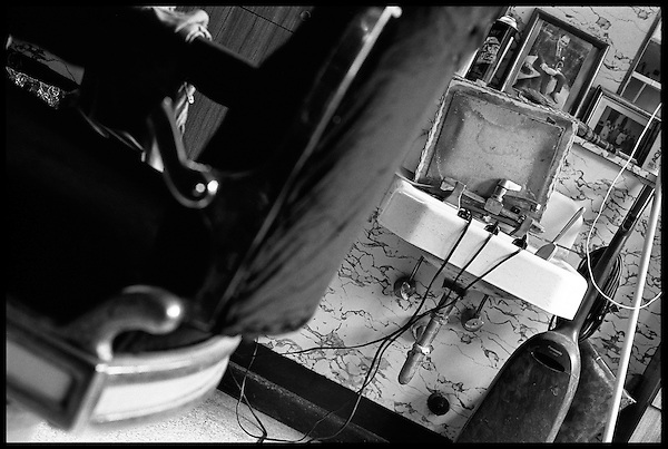 The tools of the trade, 3 types of clippers and the chair. Carruso sits over the sink. .
