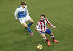 Atletico de Madrid's Juanfran Torres (r) and UD Almeria's Sebastian Dubarbier during La Liga match.February 21,2015. (ALTERPHOTOS/Acero)