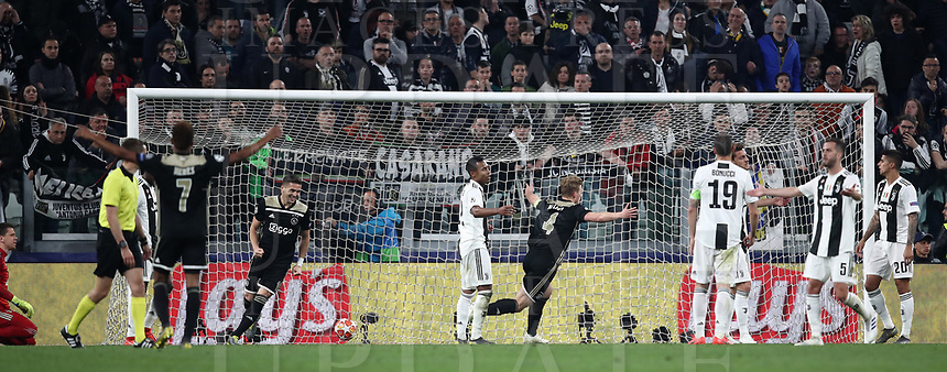 Football Soccer: UEFA Champions UEFA Champions League quarter final second leg Juventus - Ajax, Allianz Stadium, Turin, Italy, March 12, 2019. <br /> Ajax's captain Matthijs de Ligt (c) celebrates after scoring during the Uefa Champions League football match between Juventus and Ajax  at the Allianz Stadium, on March 12, 2019.<br /> UPDATE IMAGES PRESS/Isabella Bonotto