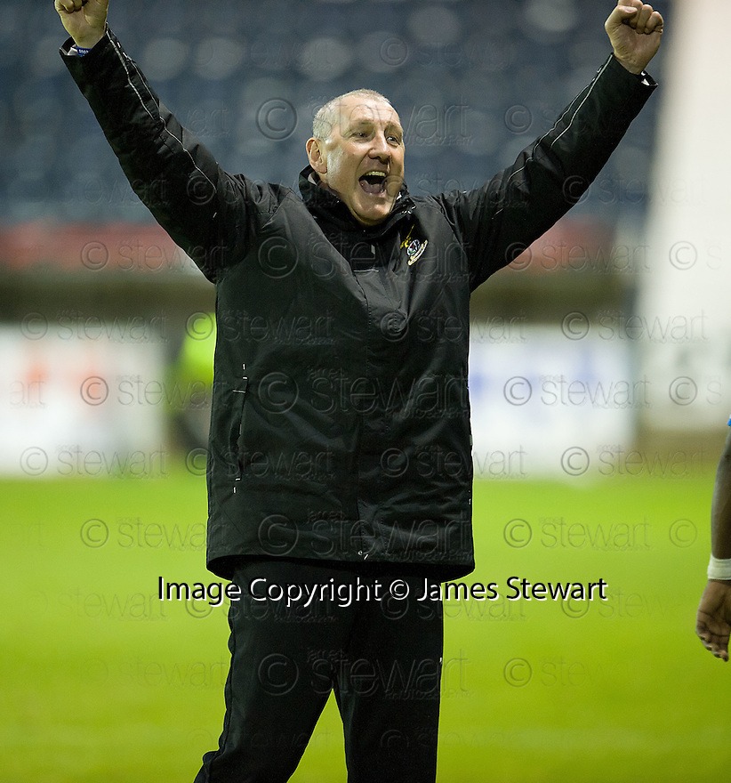 CALEY MANAGER TERRY BUTCHER CELEBRATES AT THE END OF THE GAME.