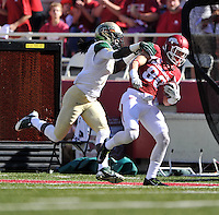 NWA Media/Michael Woods --10/25/2014-- w @NWAMICHAELW...University of Arkansas receiver Drew Morgan (80) tries to get away from Alabama Birmingham defender Jimmy Dean after catching a long pass in the 1st quarter of Saturday's game at Razorback Stadium in Fayetteville.