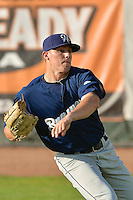 Trevor Seidenberger (38) of the Helena Brewers warms up in the outfield prior to the game against the Ogden Raptors at Lindquist Field on July 23, 2013 in Ogden Utah. (Stephen Smith/Four Seam Images)