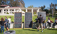 "Chalk board in the quad with ""Before I die…"" written next to it, sponsored by the InterVarsity Christian Fellowship group, Jan. 22, 2014. Students filled the board with their goals. (Photo by Marc Campos, Occidental College Photographer)"