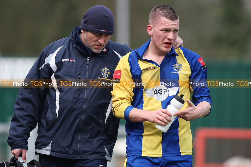 Alex Read of Romford leaves the field for treatment and is subsequently substituted - Harlow Town vs Romford - Ryman League Division One North Football at Barrows Farm - 26/03/11 - MANDATORY CREDIT: Gavin Ellis/TGSPHOTO - Self billing applies where appropriate - Tel: 0845 094 6026
