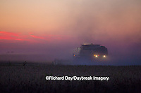 63801-06604 John Deere combine harvesting soybeans at sunset, Marion Co., IL