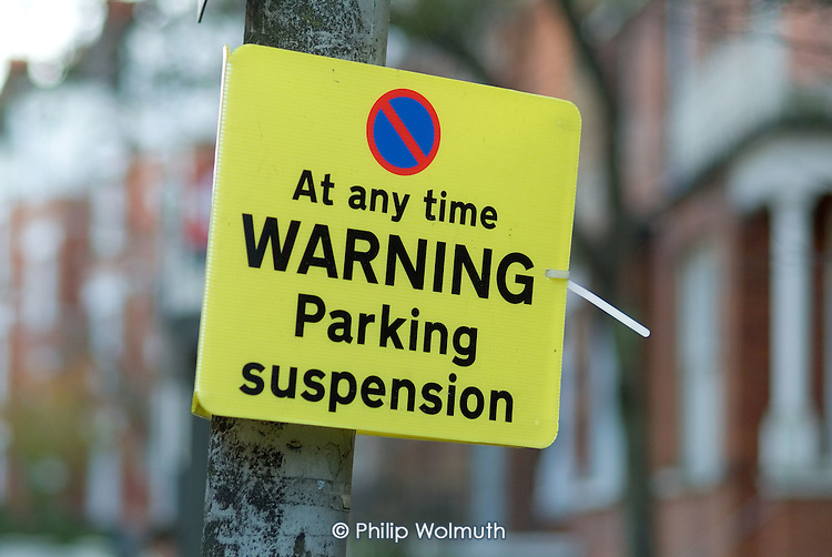 Parking suspension sign, London.