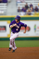 LSU Tigers outfielder Raph Rhymes #4 runs to third base against the Auburn Tigers in the NCAA baseball game on March 23, 2013 at Alex Box Stadium in Baton Rouge, Louisiana. LSU defeated Auburn 5-1. (Andrew Woolley/Four Seam Images).