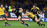 Beauden Barrett of the All Blacks gets away from James O'Connor of the Wallabies during the Rugby Championship match between Australia and New Zealand at Optus Stadium in Perth, Australia on August 10, 2019 . Photo: Gary Day / Frozen In Motion