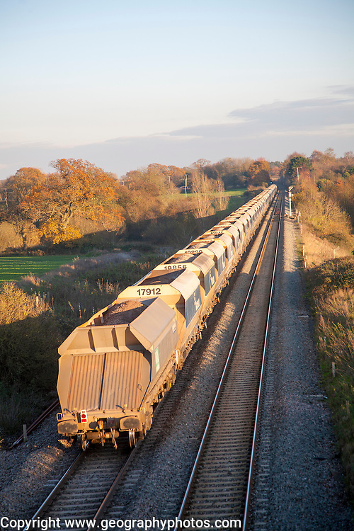Open waggons of freight train on the West Coast mainline at Woodborough, Wiltshire, England, UK