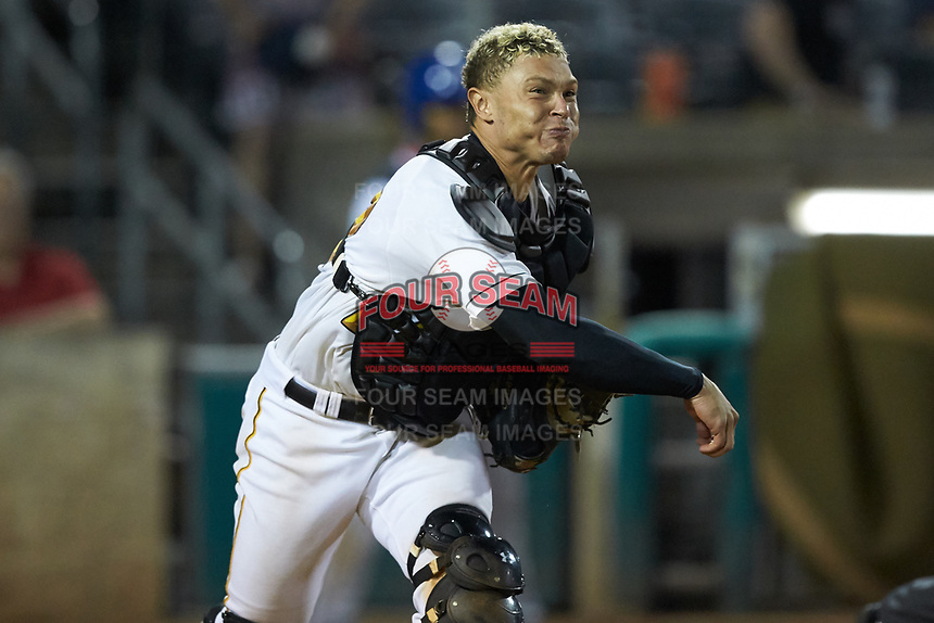 West Virginia Power catcher Deon Stafford (22) makes a throw to first base against the Lexington Legends at Appalachian Power Park on June 7, 2018 in Charleston, West Virginia. The Power defeated the Legends 5-1. (Brian Westerholt/Four Seam Images)