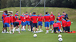 Ally McCoist gathers his larger tham usual squad around him for a pep talk after training