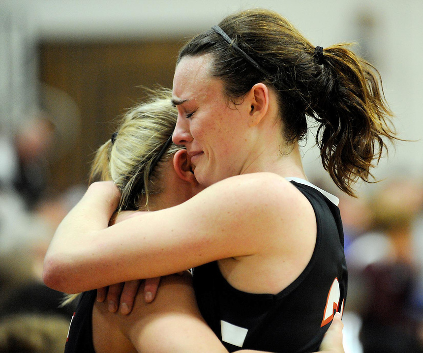 Homestead senior basketball player Siena Mitman embraces a teammate after Mitman fouled out late in the WIAA tournament game at Menomonee Falls High on Tuesday, March 8, 2011. It was her last game as a high school basketball player. Mitman was the game's high scorer. Ernie Mastroianni photo.