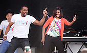 First Lady Michelle Obama dances with members of the All Stars from from the television show 'So You Can Dance' during the annual White House Easter Egg Roll on the South Lawn April 6, 2015 in Washington, DC.<br /> Credit: Olivier Douliery / Pool via CNP