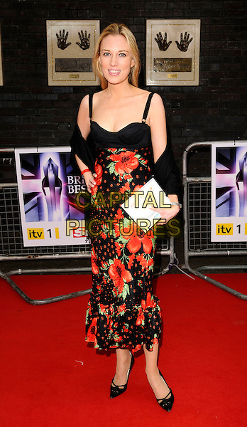 IMOGEN LLOYD WEBBER .The Britain's Best 2008 Ceremony, The London Studios, South Bank, London, England..May 18th, 2008.full length black dress weber red floral print wrap hand on hip .CAP/CAN.©Can Nguyen/Capital Pictures.