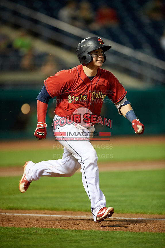 State College Spikes catcher Alexis Wilson (26) runs to first base during a game against the West Virginia Black Bears on August 30, 2018 at Medlar Field at Lubrano Park in State College, Pennsylvania.  West Virginia defeated State College 5-3.  (Mike Janes/Four Seam Images)