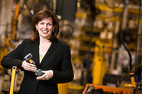 "Alumni Profile: Portrait of Lafayette College Alum Sherry Welsh, Vice President of Global Sales for auto parts maker Arvin Meritor. Here she is standing on the ""Cradle Assembly Line where the front suspension module  for Jeeps are made....4373...........................................................................................................................................................................................................................................................................................................................................................................................................4372"