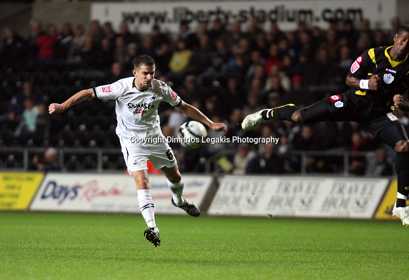 Pictured: Ferrie Bodde of Swansea (L) shoots the ball which deflects off a Queens Park Rangers defender.<br /> Re: Coca Cola Championship, Swansea City Football Club v Queens Park Rangers at the Liberty Stadium, Swansea, south Wales 21st October 2008.