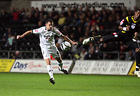 Pictured: Ferrie Bodde of Swansea (L) shoots the ball which deflects off a Queens Park Rangers defender.<br />