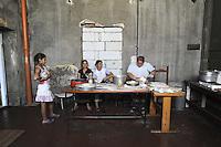 Roma, 6 Giugno 2010.<br /> Metropoliz.<br /> Ex fabbrica abbandonata Fiorucci occupata ..L'edificio &egrave; occupato da un gruppo di Rom Romeni. .Festa con pranzo tradizionale e ciclofficina per finanziare i lavori di ristrutturazione..Le donne Rom in cucina preparano il pranzo.Rome, June 6, 2010.Fiorucci  abandoned factory busy..The building is occupied by a group of Romanian Roma..Celebration with traditional lunch and &quot;Ciclofficina&quot;(bicycle repair) to finance renovation.Romani women in the kitchen preparing lunch