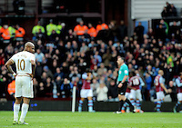 Jordan Ayew of Aston Villa celebrates his goal as brother Andre Ayew of Swansea City looks on who later scored the winning goal during the Barclays Premier League match between Aston Villa v Swansea City played at the Villa Park Stadium, Birmingham on October 24th 2015
