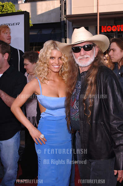 Actress/pop star JESSICA SIMPSON  & actor WILLIE NELSON at the Los Angeles premiere of their new movie The Dukes of Hazzard..July 28, 2005 Los Angeles, CA.© 2005 Paul Smith / Featureflash