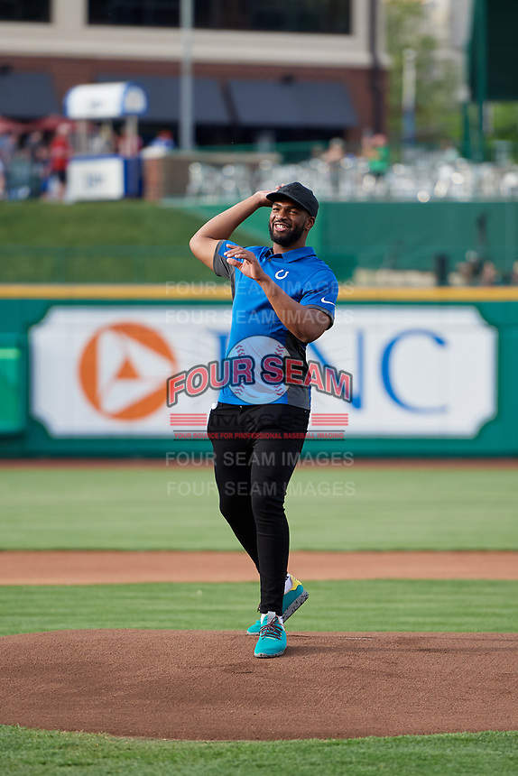 Indianapolis Colts wide receiver Donte Moncrief throws out the first pitch before a Fort Wayne TinCaps game against the West Michigan Whitecaps on May 17, 2018 at Parkview Field in Fort Wayne, Indiana.  Fort Wayne defeated West Michigan 7-3.  (Mike Janes/Four Seam Images)