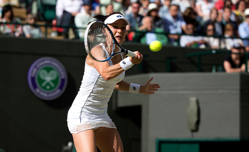 Agnieszka Radwanska (POL) [13] in action during her victory over Madison Keys (USA) [21] in their Ladies' Singles Quarter Final match today - Agnieszka Radwanska (POL) [13] def Madison Keys (USA) [21] 7-6(3) 3-6 6-3<br /> <br /> Photographer Stephen White/CameraSport<br /> <br /> Tennis - Wimbledon Lawn Tennis Championships - Day 8 - Tuesday 7th July 2015 -  All England Lawn Tennis and Croquet Club - Wimbledon - London - England<br /> <br /> &copy; CameraSport - 43 Linden Ave. Countesthorpe. Leicester. England. LE8 5PG - Tel: +44 (0) 116 277 4147 - admin@camerasport.com - www.camerasport.com.