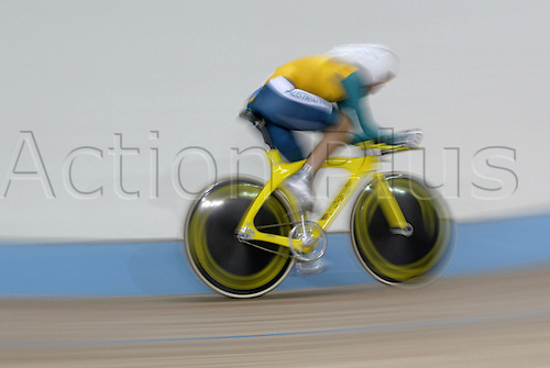 21 August 2004: Effect picture of Australian cyclist Katherine Bates (AUS) in action during heat 3 of the Women's Individual Pursuit Qualifying held at The Olympic Velodrome. 2004 Olympic Games, Athens, Greece. Photo: Neil Tingle/Action Plus...040821 olympics olympic bicycle bike track cycling velodrome movement speed effect blur camera effects..woman womens female
