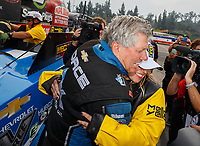 Nov 12, 2017; Pomona, CA, USA; NHRA funny car driver John Force (left) celebrates with daughter top fuel driver Brittany Force after she clinched the 2017 NHRA top fuel dragster world championship during the Auto Club Finals at Auto Club Raceway at Pomona. Mandatory Credit: Mark J. Rebilas-USA TODAY Sports