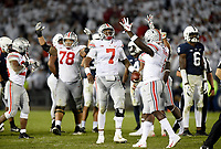 STATE COLLEGE, PA - SEPTEMBER 29: Ohio State G Demetrius Knox (78), QB Dwayne Haskins, Jr. (7), and WR Johnnie Dixon III (1) celebrate as time expires. The Ohio State Buckeyes defeated the Penn State Nittany Lions 27-26 on September 29, 2018 at Beaver Stadium in State College, PA. (Photo by Randy Litzinger/Icon Sportswire)
