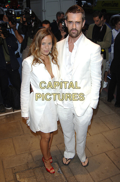 JADE JAGGER & RUPERT EVERETT.Attend The Art of Fashion event, in association with Breakthrough Breast Cancer, The Dorchester, London, June 9th 2005..full length white shirt dress red shoes.Ref: PL.www.capitalpictures.com.sales@capitalpictures.com.©Capital Pictures