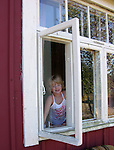 Child in Window on Island of Kökar, Åland, Finland