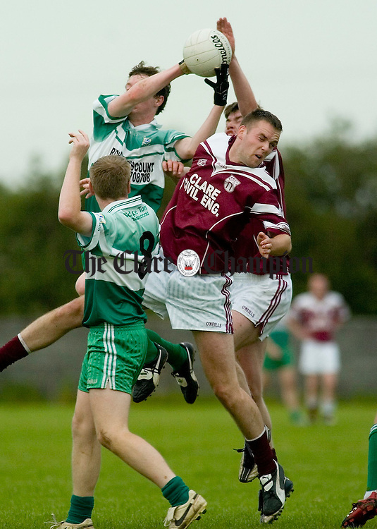 Wolfe Tones Terry Duggan catches the ball above Doora Barefields Greg Lyons as Barry Murphy of Wolfe Tones looks on during their U-21 championship semi final at Clareabey. Photograph by John Kelly.