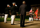 United States President George W. Bush (R) reviews Marines at a military parade with Michael W. Hagee (C), commandant of the Marine Corps, and Col. Terry M. Lockard  May 5, 2006, at the Marine Barracks on Capitol Hill in Washington, DC. A House panel this week approved a measure that would increase funding to add 5,000 more Marines, bringing the overall troop size for the Corps to 180,000.  <br /> Credit: Joshua Roberts / Pool via CNP