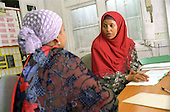 Surer Abshir Musse offers immigration and welfare rights advice to a client at the Somali Community Information Centre in North Paddington, London
