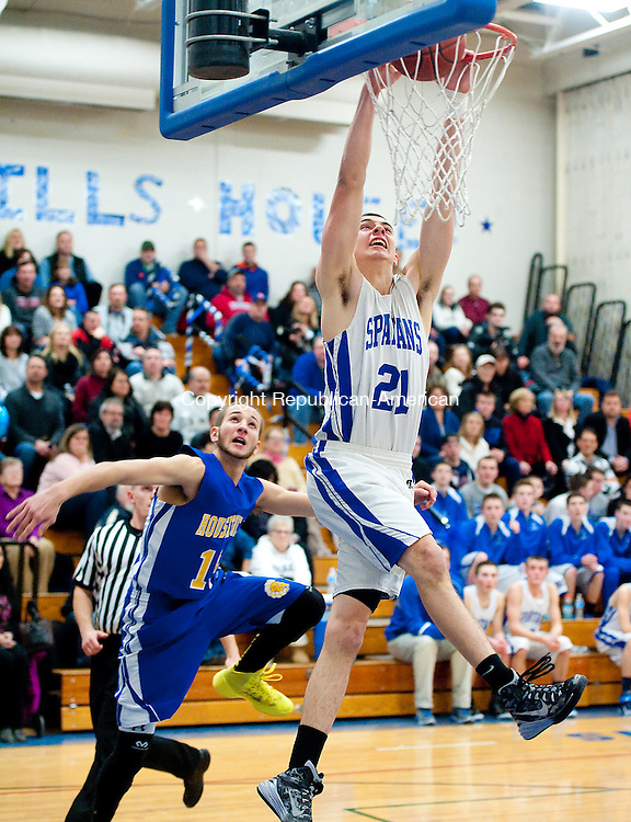 BURLINGTON,  CT-021315JS04- Lewis Mills' Nate Cook (21) slams in two points in front of Housatonic's Nick Camardi (15) during their game Friday at Lewis Mills High School in Burlington. <br />  Jim Shannon Republican-American