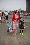 Uruguay 2 United Arab Emirates 1, Great Britain 1 Senegal 1, 26/07/2012. Old Trafford, Olympic Games. A woman supporter of the Great Britain football team wearing a Union Jack dress and carrying possessions in a security bag walking towards Manchester United's Old Trafford stadium prior to the Men's Olympic Football tournament matches at the venue. The double header of matches resulted in Uruguay defeating the United Arab Emirates by 2-1 while Great Britain and Senegal drew 1-1. Over 72,000 spectators attended the two Group A matches. Photo by Colin McPherson.