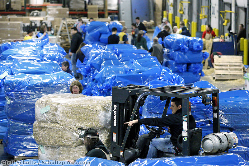 Airland Transport employee J.C. Sneed uses a forklift to move some of the 1500 bales of straw at Airland Transport in Anchorage to be sent out to the 22 checkpoints along the Iditarod trail Thursday, Feb. 7, 2013.