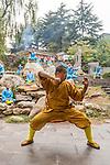 Shaolin martial arts school ShiFu and students practicing Qi Gong and meditation outside at the opening ceremony of Zhengzhou International Wushu Fetival in DengFeng, Henan, China 2014