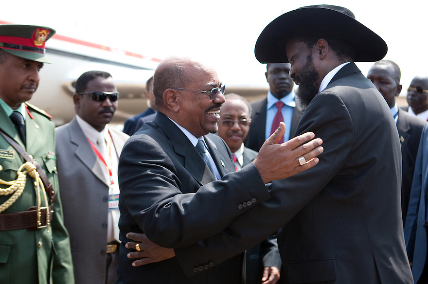 Saturday 9 july 2011 - Juba, Republic of South Sudan - South Sudan's President Salva Kiir (R) welcomes Sudan's President Omar Hassan al-Bashir at Juba International airport. Al-Bashir arrives at Juba airport for the Independence Day celebrations in South Sudan's capital Juba..Photo credit: Benedicte Desrus
