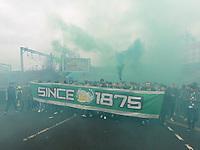 26th December 2019; Tynecastle Park, Edinburgh, Scotland; Scottish Premiership Football, Heart of Midlothian versus Hibernian FC; Hibs fans march to the stadium whoe letting off green flares