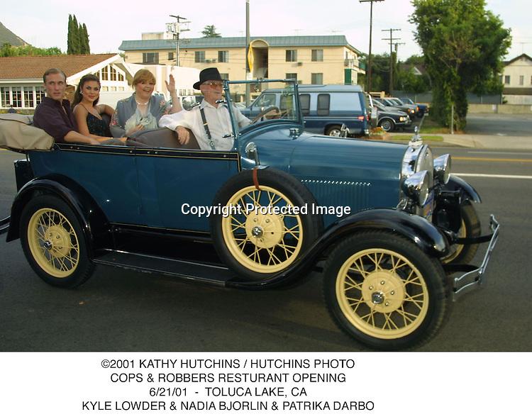 ©2001 KATHY HUTCHINS / HUTCHINS PHOTO.COPS & ROBBERS RESTURANT OPENING.6/21/01  -  TOLUCA LAKE, CA.KYLE LOWDER & NADIA BJORLIN & PATRIKA DARBO