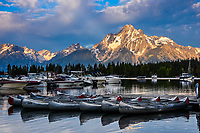 Boats and canoes waiting for the day's business to start, sit quietly at Colter Bay Marina on Jackson Lake in Grand Teton National Park.