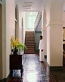 SRI LANKA, Asia, Galle, butler standing inside the Amangalla Hotel