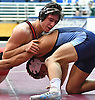 Michael Minnici of Plainedge, left, battles Ron Espinal of Oceanside at 152 pounds during the Nassau County Divsision I varsity wrestling quarterfinals at Hofstra University on Saturday, Feb. 11, 2017. Minnici scored on an an escape with a minute left to win by decision 1-0.