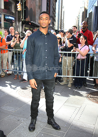 NEW YORK, NY-June 14: Jessie T. Usher from the cast of  Independence Day: Resurgence ring Nasdaq Stock Open Bell  at Nasdaq Time Square in New York. NY June 14, 2016. Credit:RW/MediaPunch