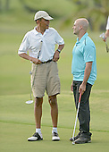 United States President Barack Obama talks to Sam Kass before putting on the 18th green at the Mid Pacific Country Club in Lanikai, Hawaii on January 1, 2014.<br /> Credit: Cory Lum / Pool via CNP